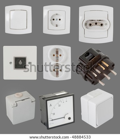 Electric components isolated on gray - stock photo