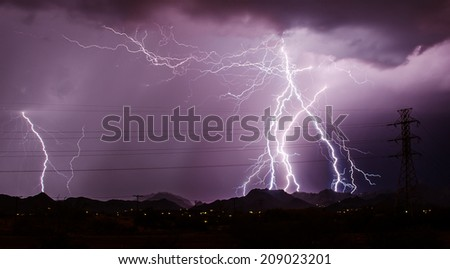 Electric concentration of lightning and power lines - stock photo