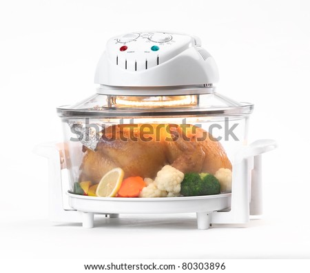 Electric convection oven with whole chicken inside - stock photo