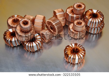 Electric copper coils on metal background  - stock photo