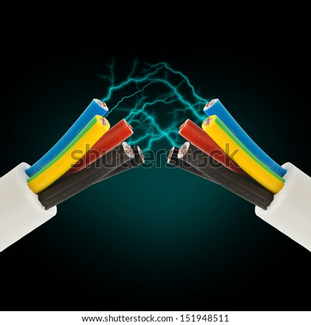 Electric cord with electricity sparkls as symbol of power - stock photo