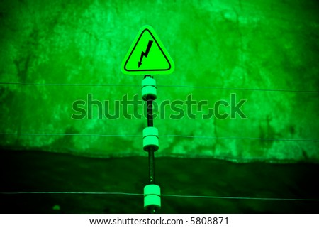 Electric danger sign. Acid green color like a toxic factory. - stock photo