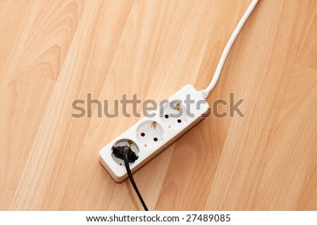 Electric extension cable on the floor - stock photo
