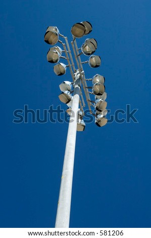 Electric floodlights at a neighborhood sports field.