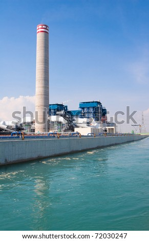 Electric generator power plant behind the canal of cooling water ventilation systems - stock photo