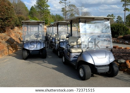 electric golf carts for rent at course in georgia usa - stock photo
