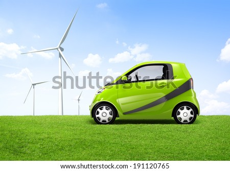 Electric green car in the outdoor with a view of windmill behind it. - stock photo