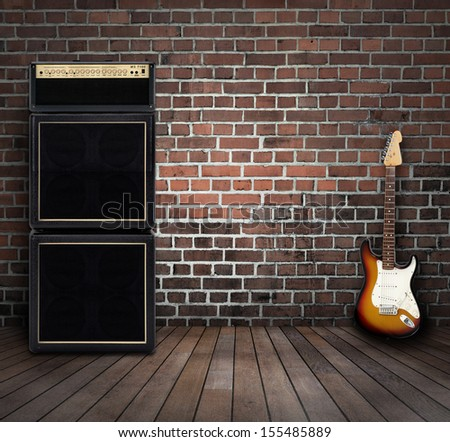 Electric guitar and amplifier in a room - stock photo