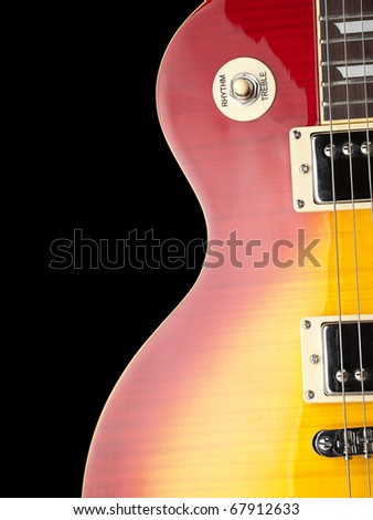 electric guitar body,closeup over black background, for music and entertainment themes - stock photo