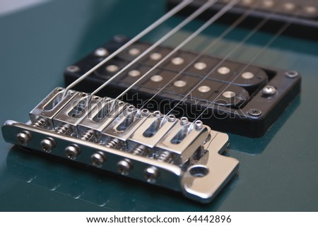 Electric guitar close-up isolated on white - stock photo