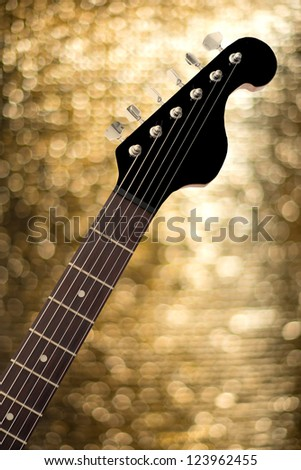 Electric Guitar head with natural and relax bokeh background - stock photo