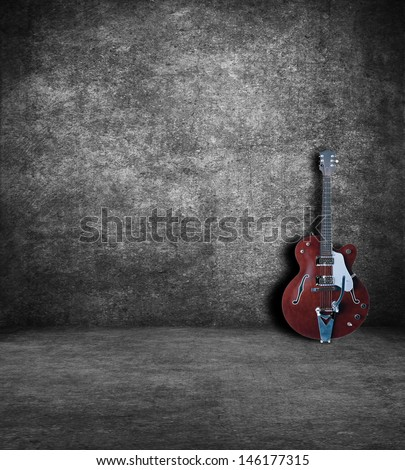 Electric guitar in an old abandoned interior. - stock photo