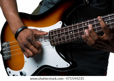 Electric guitar in close up of the camera. Male hands on the strings of the expensive musical instrument for playing rock and roll.
