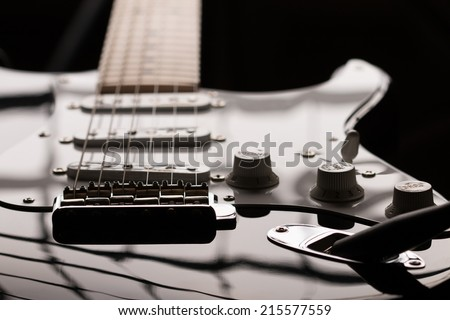 Electric guitar in dark key at unusual angle - stock photo