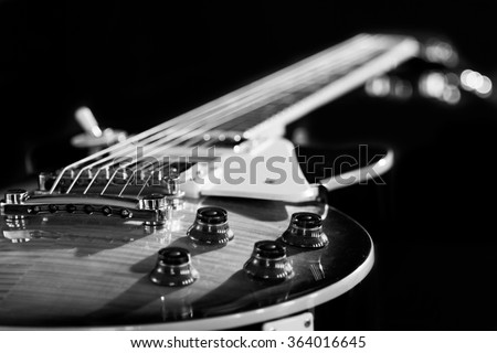 Electric guitar isolated on a black background black and white photo - stock photo