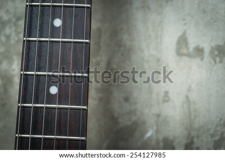Electric guitar near the concrete wall