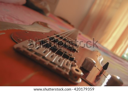 Electric guitar old wooden surface  - stock photo