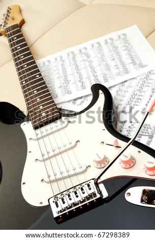 electric guitar on a sofa - stock photo