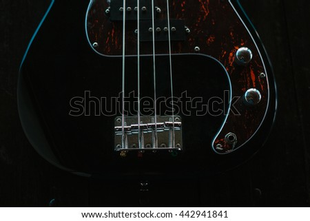 Electric guitar on a wooden surface. Conceptual background. - stock photo