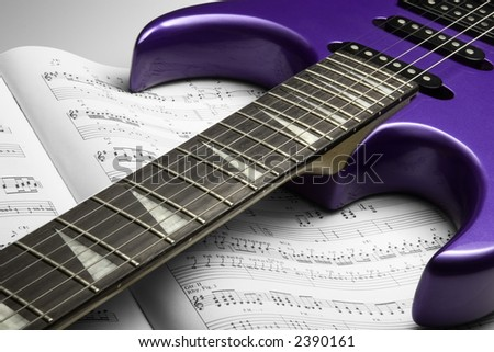 Electric Guitar on Sheet Music - stock photo