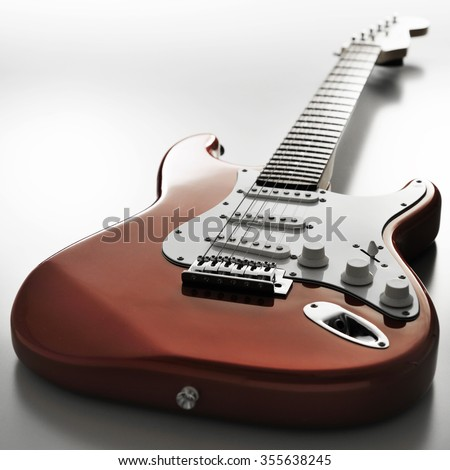 Electric guitar on the floor - stock photo