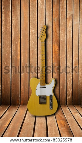 Electric guitar on wood wall - stock photo