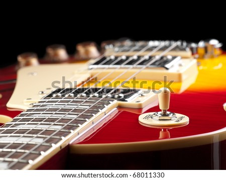 electric guitar over black background, low angle shot, for music and entertainment themes - stock photo