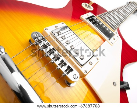 Electric guitar over white background,low angle shot, for music and entertainment themes - stock photo