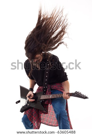 Electric guitar player on a white background playing the rock music - stock photo