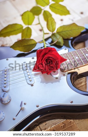electric guitar red rose - stock photo