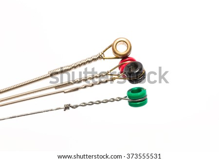 electric guitar strings isolated on white background - stock photo