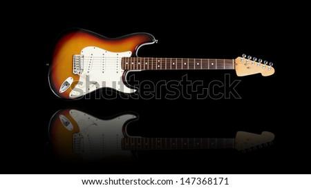 Electric guitar, sunburst, reflection - stock photo