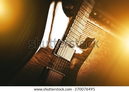 Electric Guitar Theme. Electric Guitar Playing Music Closeup Photo Concept - stock photo