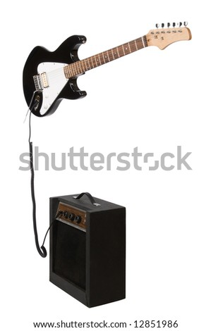 Electric guitar with amp isolated on white background - stock photo