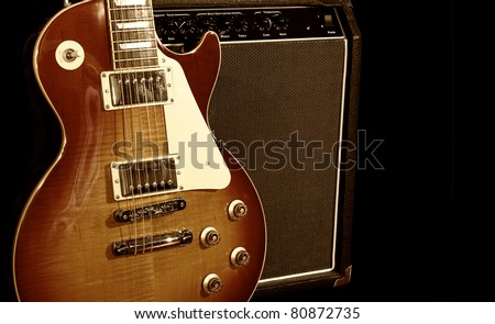Electric Guitar With Amplifier Isolated on Black Background - stock photo