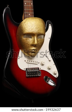 electric guitar with gold mask