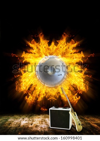 Electric Guitar with loudspeaker on Fire  - stock photo