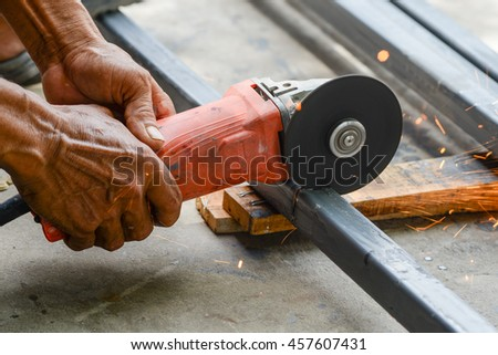 Electric hand wheel grinding on steel ,Grinder in hand