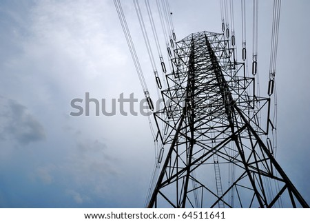 Electric high voltage post with sky background - stock photo