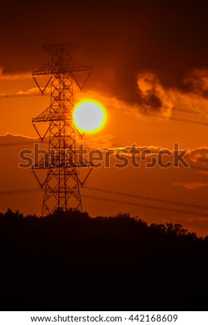 Electric high voltage power in the field with sunset background.