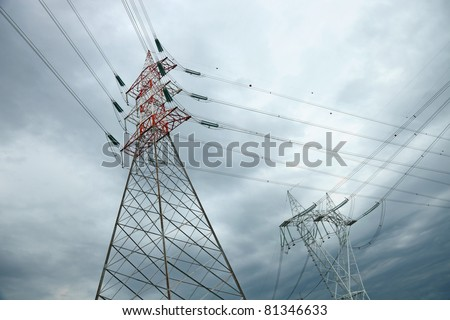 electric high voltage pylon against dramatic sky - stock photo