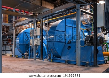Electric Industrial generator inside power plant closeup - stock photo