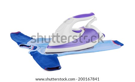 Electric iron on baby clothes, isolated on white - stock photo