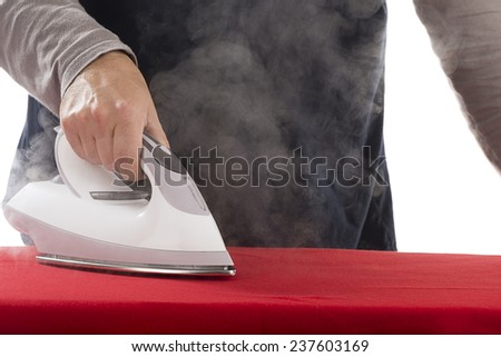 Electric iron with steam on white background.