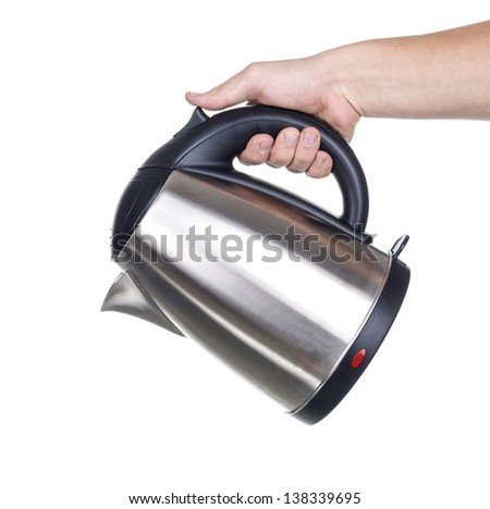 Electric kettle in hand isolated on white - stock photo