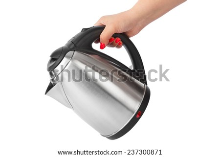 Electric kettle in hand isolated on white background - stock photo