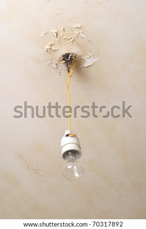 Electric lamp hanging from repair ceiling