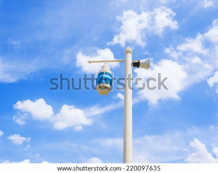 electric lamp install outdoor on the park, on blue sky background - stock photo
