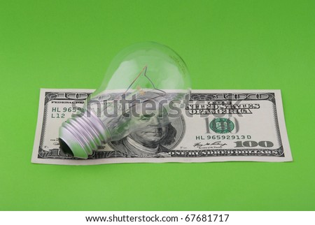 electric lamp on hundred dollars. On green background