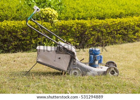 electric lawn mower in the park